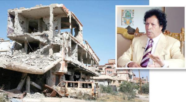 ساختمان های ویران شده در اثر درگیری بین گروه های لیبی (رویترز) در گوشه تصویر احمد قذاف الدم